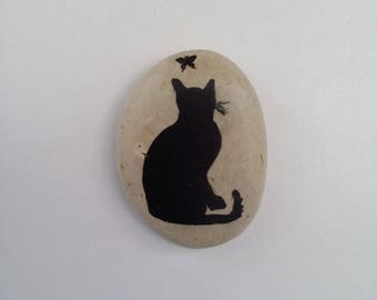 Stone black cat and Butterfly