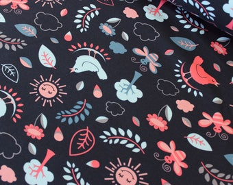 Beautiful floral and forest themed in navy cotton jersey