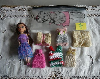 7/small doll and her wardrobe.