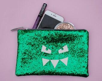 Monster glitter clutch bag