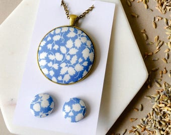 Blue Vine 38mm Pendant Necklace with 76cm Antique Brass Rolo Chain and Lobster Clasp • 15mm Fabric Button Earrings • Surgical Steel