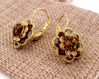 Earring golden metal with Swaroski rhinestones