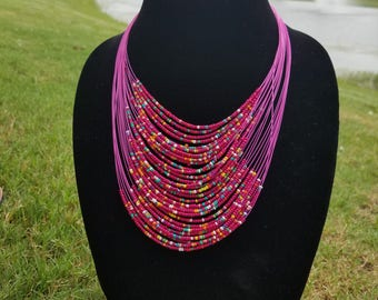 A Fuchsia  Multiple Strand Maasai Necklace with Mixed Beads