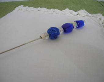 A Vintage hatpin shank holds blue and crystal beads