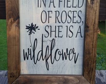Wildflower, distressed wooden sign. In a field of roses, she is a wildflower