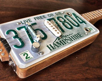 License plate Cigarbox guitar (also available with other signs)