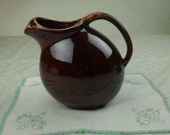 Oven proof brown milk or water pitcher.
