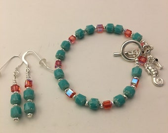 """6 3/4"""" bracelet with small cathedral beads, Swarovski Crystal cubes, a seahorse charm, toggle clasp and matching earrings."""
