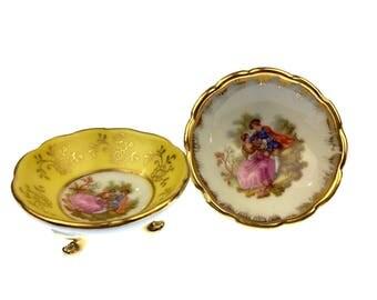"Pair of French Limoges Porcelain Footed Finger Bowls, Open Salts of lovers w/ floral details in gold trim. Inscription ""Limoges, France""."