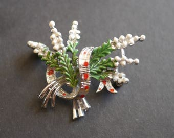 Lucky white heather metal and enamel brooch marked Exquisite