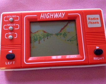 1980s RadioShack HIGHWAY handheld video game
