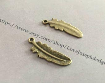 wholesale 100 Pieces /Lot Antique Bronze Plated 10mmx30mm feather Charms(#0535)