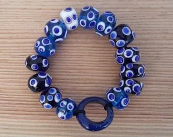 Celtic armlet - Gallic Bracelet: glass beads in ocelli blue and white