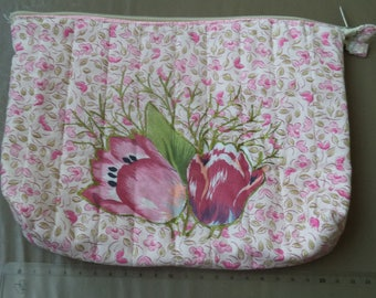 case padded with pink flowers with a zipper