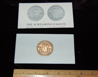 1944-1969 101st Airborne Screaming Eagle Bronze Medallion with information sheet containing unit history & medallion/manufacture info