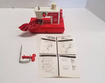 Vintage 1950's or 1960's Little Gem Toy Sewing Machine with Instructions and table clamp