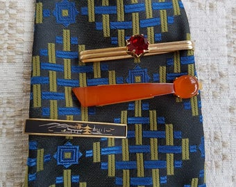 Three vintage clips for tie: red, black, amber whit yellow metal. Classy, fancy men accessories. Great as gift for someone special.