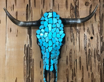 Hand decorated magnesite turquoise colored stoned cow skull