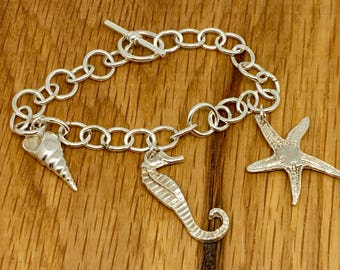 One of a kind Solid Silver Sea themed Charm Bracelet with Sea horse charm, starfish charm and seashell charm, beach lover silver bracelet