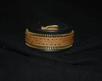 Leather strap and brass