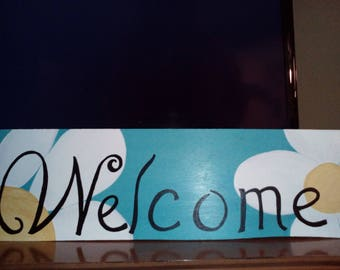 Welcome sign in turquoise and white