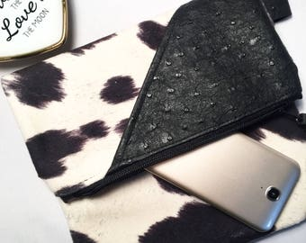 Fold over cowhide clutch