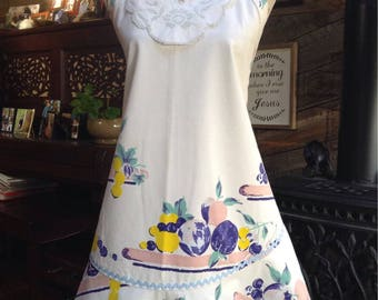 Vintage tablecloth apron  with cutwork linen jabot and vintage glass buttons.