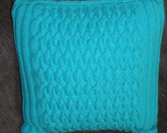 Turquoise wool upholstery cushion