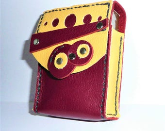 Cigarettes and lighter yellow and Burgundy leather case