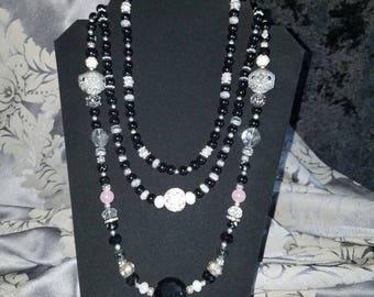 Handmade multi-stran beaded necklace