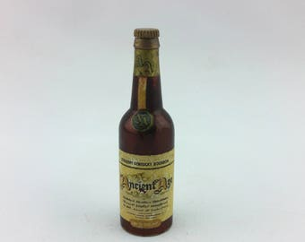Vintage 1950s Ancient Age Straight Kentucky Bourbon West Germany Brass And Steel Bottle Opener in a Bottle