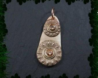 Bronze celtic button ingot pendant set with CZ