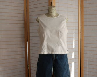 Ralph Lauren Sweet sleeveless white blouse. Buttons up da back.  I wish summer could go on forever. Size L. Cotton Spandex