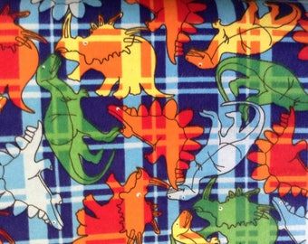 Flannel/Colorful dinosaurs on blue plaid background cotton fabric by the yard