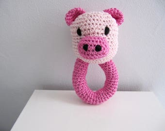 Pink pig rattle made of cotton