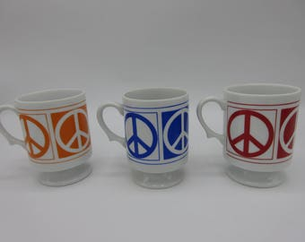 Set of Three Retro Peace Sign Footed Mugs in Red Orange and Blue Mod Retro Hippie