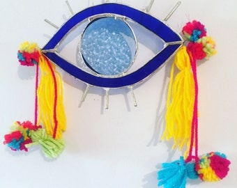 Evil Eye- glass turkish eye good luck spirit token protection curse talisman suncatcher embrlkished with rainbow pom poms and tassels