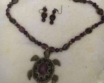 Purple and gold turtle beaded necklace with earrings