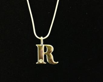 Silver plated snake chain and R charm