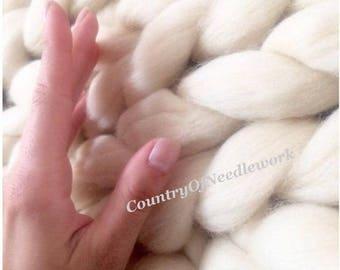 A warm blanket. Merino wool (23-25 micron merino wool) Natural White