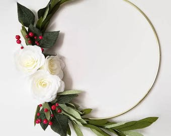 Modern winter wreath of crepe paper white roses, berries, olive branches and leaves