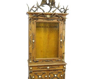 fantastic oak wood gun cabinet with antler decoration ca. 1900