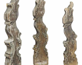 a set of three historical dragon head wood beams