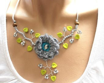 Grey crochet Flower necklace and green leaves