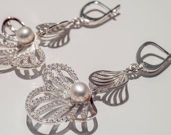 Ensemble (earrings, ring)