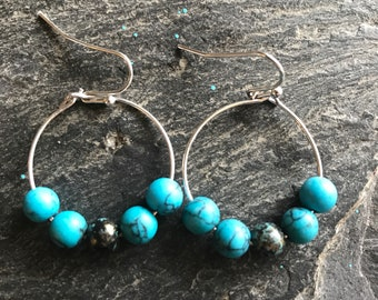 Earrings with turquoise glass beads