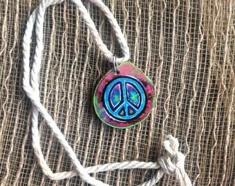 Peace sign tye dye wooden pendant on hemp