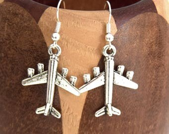 Earrings have antique silver, antiqued silver airliner clips