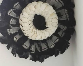 Juju hat feathers and shells