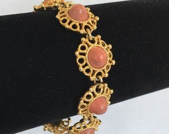 Sarah Coventry Valencia 1970s Gold Tone Filigree Bracelet with Coral Colored Cabochon Centers